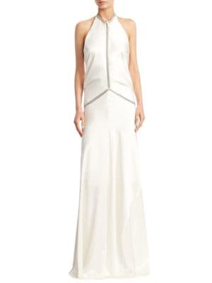 """Image of Backless silk gown with fishbone chain. Halterneck. Sleeveless. Spring ring clasp closure. Lined. About 69"""" from shoulder to hem. Silk. Dry clean. Imported. Model shown is 5'10"""" (177cm) wearing US size 2."""