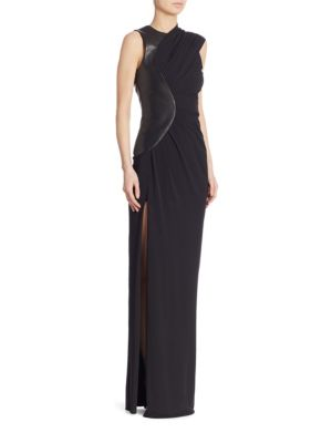 """Image of Asymmetric draped gown with curved leather panel and side slit. Surplice neckline. Sleeveless. About 65"""" from shoulder to hem. Lined. Acetate/nylon/leather/elastane. Dry clean. Imported. Model shown is 5'10"""" (177cm) wearing US size 2."""