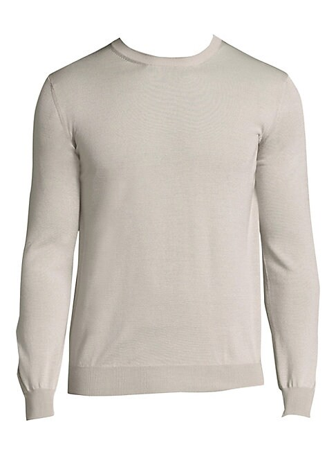 Image of Warm sweater in wool and silk blend fabric. Ribbed crewneck. Long sleeves with ribbed cuffs. Ribbed hem. Pullover style. Merino wool/silk. Dry clean. Made in Italy.