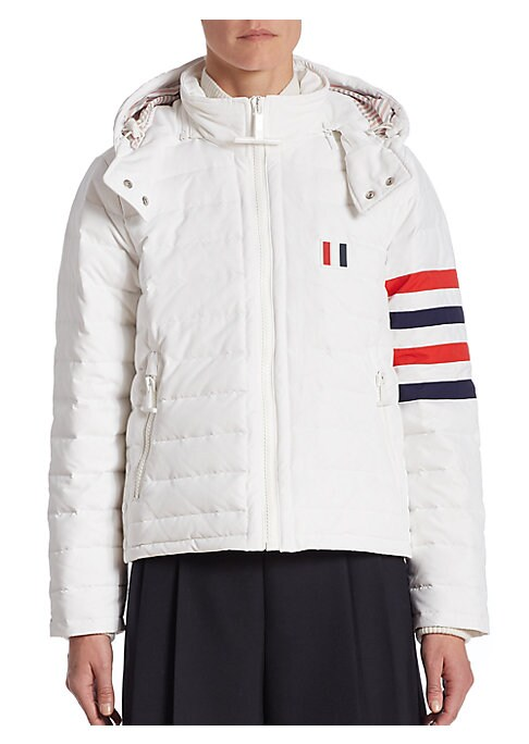 """Image of Classic goose down jacket in ripstop nylon. Stand collar. Long sleeves. Front zip pockets. Exposed front zip. About 25"""" from shoulder to hem. Nylon. Dry clean. Made in Italy. Model shown is 5'10"""" (177cm) wearing US size 4."""
