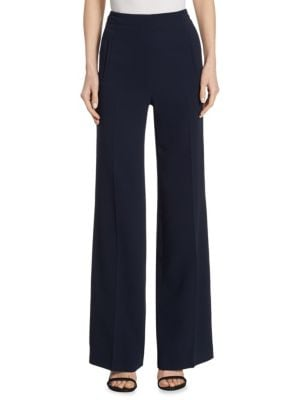"""Image of Streamlined stretch wide-leg pant with flared hem. Banded waist. Concealed side zip. Front welt pockets. Rise, about 12"""".Inseam, about 30"""".Viscose/acetate/elastane. Dry clean. Imported. Model shown is 5'10"""" (177cm) wearing US size 4."""