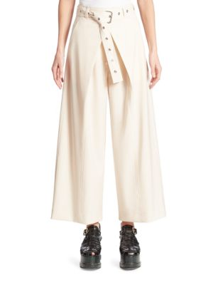 "Image of Belted culotte in lightweight virgin wool. Belted waist. Front zip fly with concealed closure. Front seam pockets. Pull-on style. Rise, about 9"".Inseam, about 29"".Wool/elastane. Dry clean. Made in Italy. Model shown is 5'10"" (177cm) and wearing US size 4."