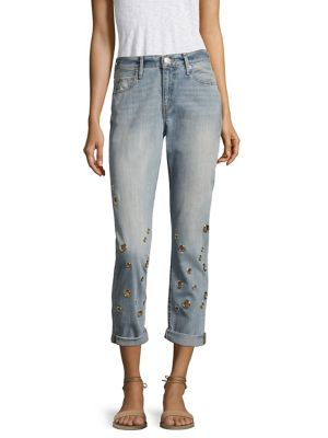 """Image of Oversize mixed grommets punctuate cuffed cotton boyfriend jean. Belt loops. Zip fly with button closure. Five-pocket style. Rise, about 12"""".Inseam, about 29"""".Cotton. Machine wash. Imported. Made in USA. Model shown is 5'10"""" (177cm) wearing US size 4."""