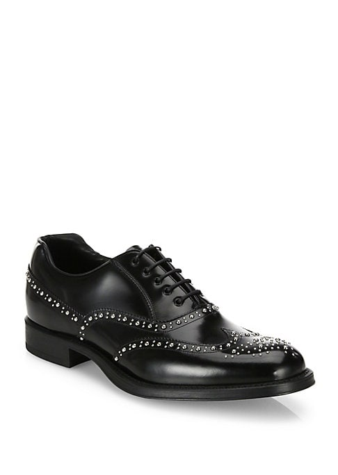 Image of Polished leather wingtip shoe embellished with studs. Leather upper. Lace-up vamp. Leather lining. Rubber sole. Made in Italy.