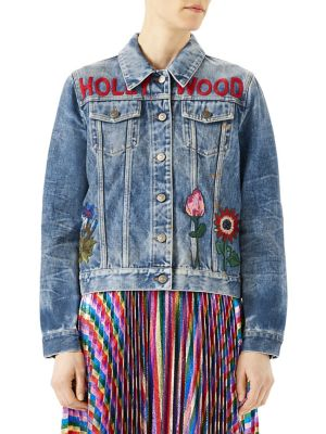 Image of The denim jacket has become a defining feature of Alessandro Michele's collections. The individually embroidered appliques are sewn to the garment by hand. Classic Hollywood denim jacket with flower and bunny embroidered appliques. Point collar. Long slee