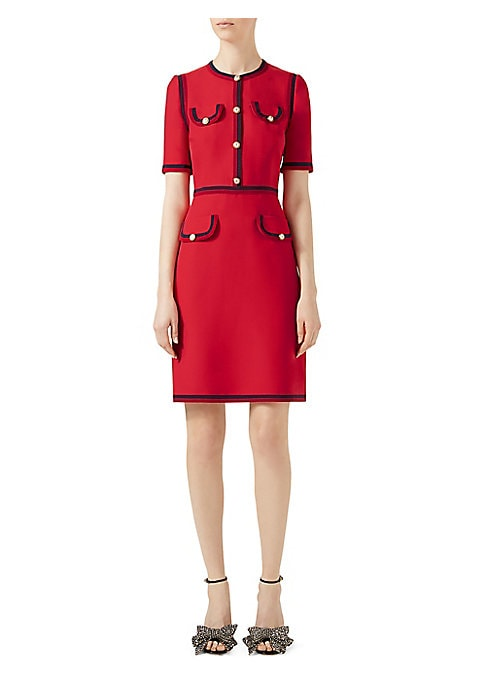 Image of First developed by Gucci in the 50s. Here it is used to frame the edges of this knee length dress. The GG pearl buttons are a new signature element of the brand. The crepe wool silk is a light soft fabric with a creased appearance. Roundneck. Short sleeve