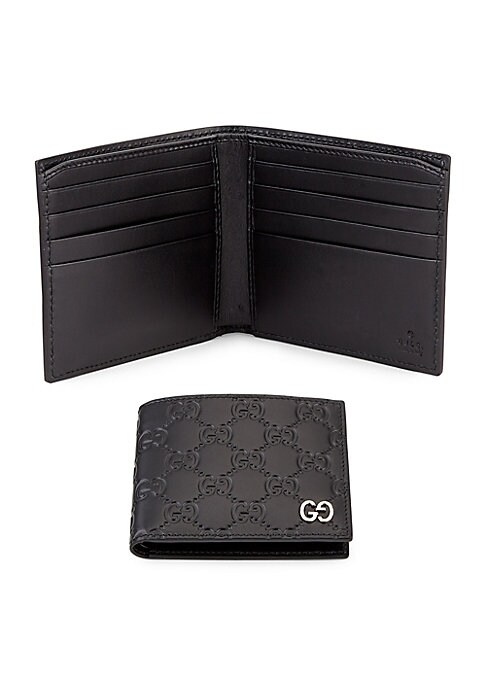 "Image of A bi-fold wallet made in heat debossed Gucci Signature leather with a defined print and firm texture. At the corner is a GG metal detail that reflects the Gucci Signature motif. Eight interior credit card slots. Two interior bill compartments.4.5""W x 3.5"""