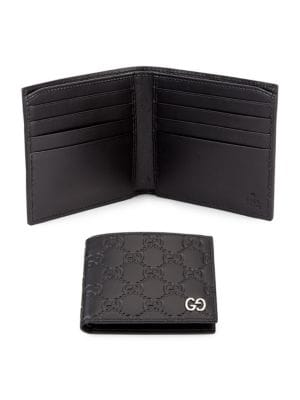 Embossed Gg Leather Bifold Wallet by Gucci