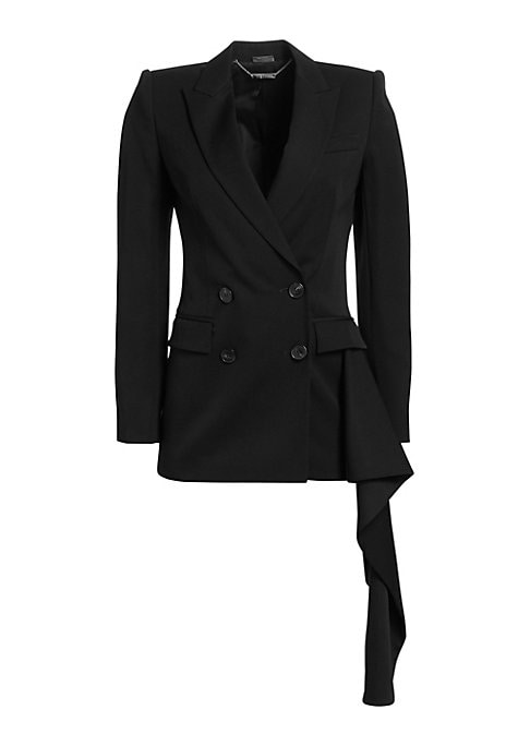 """Image of Chic double-breasted blazer with cascading ruffle. Peak lapel. Long sleeves. Buttoned cuffs. Double-breasted button front. Chest welt pocket. Waist flap pockets. Asymmetrical side ruffle. Lined. About 29"""" from shoulder to hem. Wool. Dry clean. Made in Ita"""