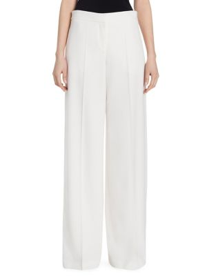 "Image of Billowing creased wide-leg pant cut from Italian wool. Banded waist. Zip fly with hook-and-eye closure. Side slash pockets. Back buttoned welt pocket. Lined. Rise, about 9"".Inseam, about 32"".Wool. Dry clean. Made in Italy. The model is 5'10"" and is wearin"