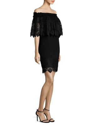 "Image of Cape dress featuring an embroidered lace design. Off-the-shoulder neckline. Side seam pocket. About 35"" from shoulder to hem. Lined. Nylon. Dry clean. Imported. Model shown is 5'10"" (177cm) wearing US size 4."