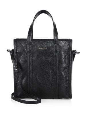 """Image of From the Carry Over Collection. Spacious shopping companion crafted from leather. Double top handles. Shoulder straps. Top zip closure. One inside zip pocket. One inside slip pocket.11"""" W x 11"""" H x 6"""" D.Leather. Made in Italy."""