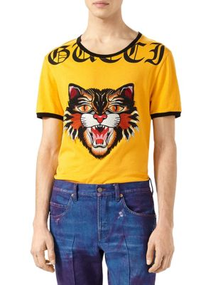 """Image of The image of the Angry Cat-strongly represented in the Pre-Fall collection is embroidered and applied to the front of the cotton t-shirt. Along the neckline is a portion of the word """"Gucci"""" printed in Gothic-style lettering. Crewneck. Short sleeves. Embro"""