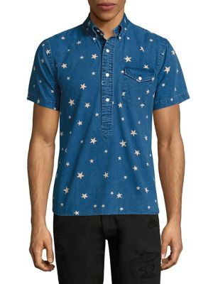 Image of Cotton shirt featuring an allover star-print. Button-down point collar. Short sleeves. Four-button placket. Chest buttoned flap pocket. Curved hem. Cotton. Machine wash. Imported.