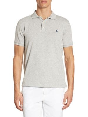 "Image of Soft and lightweight cotton polo with chest logo detail. Polo collar. Short sleeves. Rib-knit collar and cuffs. Three-button placket. Slim-fit. About 28"" from shoulder to hem. Cotton. Machine wash. Imported."