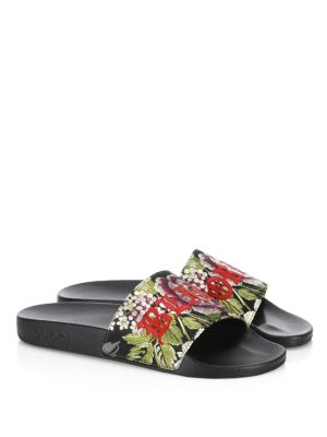 """Image of Floral jacquard with red leather """"Blind for Love"""" embroidery. Open toe. Slip-on style. Leather lining. Molded rubber footbed. Rubber sole. Made in Italy."""