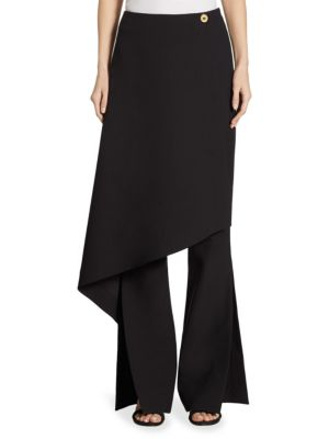 "Image of Eye-catching split trouser with wrap over skirt. Wrap over skirt with button. Split hem. Concealed center back zipper. Rise, about 12"".Inseam, about 36"".Polyester. Dry clean. Imported. Model shown is 5'10"" (177cm) wearing US size 4."