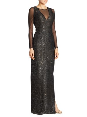 "Image of Sequin embellished illusion gown in semi-sheer design. Illusion neckline. Long sleeves. Concealed back zip. About 60"" from shoulder to hem. Polyester/wool/rayon. Dry clean. Imported. Model shown is 5'10"" (177cm) wearing US size 4."