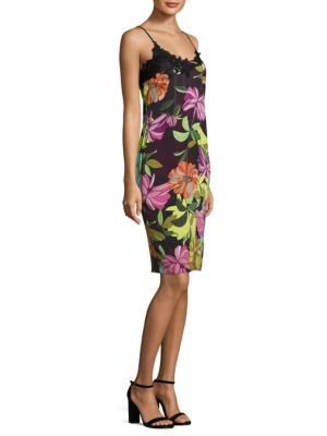 "Image of Sleeveless dress with allover floral-print and lace detail. Scoopneck. Sleeveless. Concealed back zip. Back slit. Lined. About 39"" from shoulder to hem. Rayon. Dry clean. Imported. Model shown is 5'10"" (177cm) wearing US size 4."