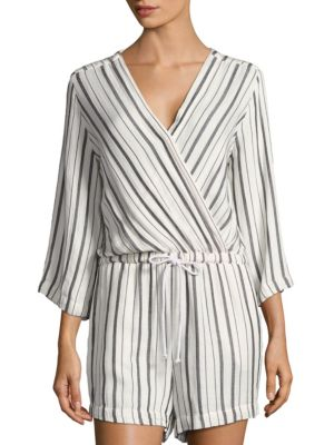 """Image of Contrasting striped pattern styles this romper. Surplice neckline. Three-quarter sleeves. Elasticized waist with drawstrings. Pleated back yoke. About 36"""" from shoulder to hem. Rise, about 14"""".Inseam, about 2"""".Leg opening, about 22"""".Viscose/linen/modal. M"""
