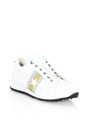 Image of This white and silver soft vacchetta low top is a new running style trainer. The elastics on the tongue mean the shoe is easy to slip-on and laces are included for added comfort. This casual shoe features a large star running through the centre of the thr