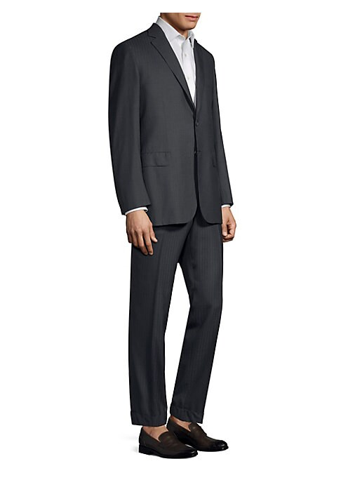 Image of A stylish woven wool suit in subtle pinstripe. Wool. Dry clean. Made in Italy. JACKET. Notch lapels. Long sleeves. Button cuffs. Button front. Chest slip pocket. Waist flap pockets. Dual back vents. PANTS. Zip fly with button closure. Side slash pockets.