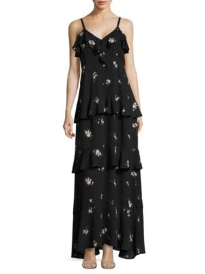 """Image of Fluttering ruffles enliven floral silk maxi dress.V-neck and back. Sleeveless. Ruffled at neck and skirt. Concealed side zip. Lined. About 53"""" from shoulder to hem. Silk. Dry clean. Imported. Model shown is 5'10"""" (177cm) wearing US size 4."""