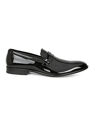 Image of Add some dapper shine to any evening outfit with these expertly designed patent leather loafers Patent leather upper Slip-on style Leather lining and sole Made in Italy. Men's Shoes - Mens Classic Footwear > Saks Fifth Avenue. Bruno Magli. Color: Black Pa