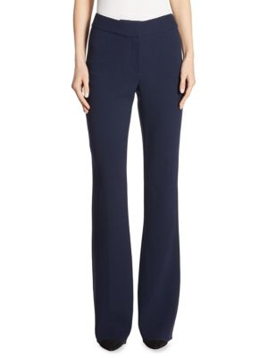 """Image of Streamlined wide-leg pant cut from stretch-wool blend. Banded waist. Zip fly with concealed hook-and-bar closure. Flared hem. Back welt pockets. Rise, about 9"""".Inseam, about 31"""".Wool/nylon/elastane. Dry clean. Made in USA. Model shown is 5'10"""" (177cm) wea"""