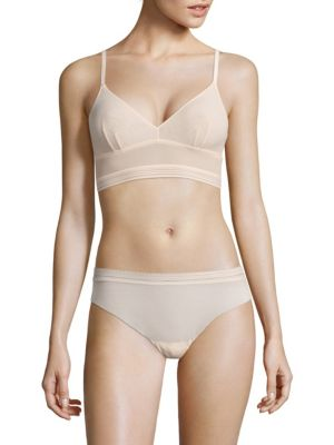 Image of .Bralette featuring lace detail with scalloped trim. .V-neck. .Sleeveless. .Adjustable shoulder straps. .Polyamide/elastane. .Hand wash. .Made in Italy. .