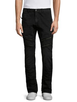 "Image of Allover zip detailing elevates slim moto-style pant. Belt loops. Zip fly with button closure. Front and side zip pockets. Inside zip cuffs. Back welt pockets. Rise, about 9"".Inseam, about 36"".Leg opening, about 15"".Cotton. Machine wash. Imported."