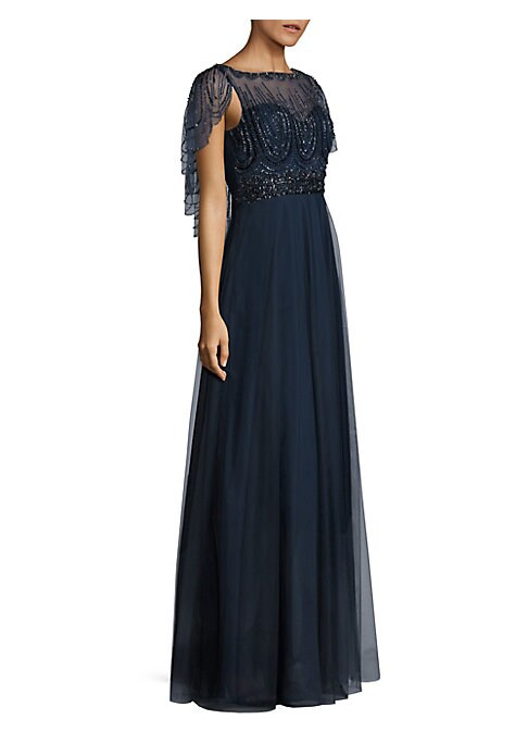 """Image of An embellished cape adds chic flair to this gown. Boatneck. Short flutter sleeves. Concealed back zip. Flared hem. Lined. About 62"""" from shoulder to hem. Polyester. Dry clean. Imported. Model shown is 5'10"""" (177cm) wearing US size 4."""