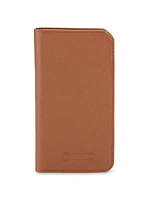 """Image of Lightweight iPhone case with reliable kickstand Fits iPhone 7 Two inside card slots One hidden slip pocket 4""""W x 9""""H Saffiano leather Imported. Men Accessories - Tech Accessories > Saks Fifth Avenue. Uri Minkoff. Color: Brown."""