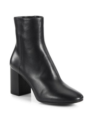 """Image of Streamlined booties made from durable leather. Self-covered block heel, 3.25""""(80mm).Leather upper. Round-toe. Side zip closure. Leather lining. Leather sole. Made in Italy."""