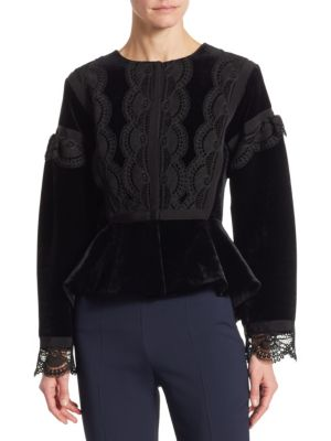"""Image of Luxe velvet peplum jacket with lace detailing. Roundneck. Long bell sleeves. Peplum hem. About 25"""" from shoulder to hem. Rayon/silk. Dry clean. Made in Italy. Model shown is 5'10"""" (177cm) wearing US size 4."""