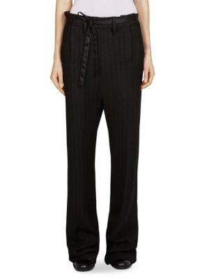 "Image of Double zip fly trouser in subtle striped design. Self-tie at waist. Double fly zip closure. Side seam pockets. Pull-on style. Rise, about 10"".Inseam, about 30"".Viscose/elastane. Dry clean. Imported. Model shown is 5'10"" (177cm) and wearing US size 4."