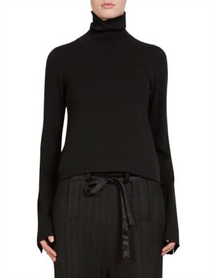 """Image of Ribbed knit turtleneck pullover in rich wool. Turtleneck. Long sleeves. Pullover style. About 25"""" from shoulder to hem. Virgin wool. Dry clean. Imported. Model shown is 5'10"""" (177cm) wearing size Small."""