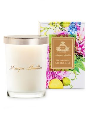 Image of Agraria's Citrus Lily Perfume Candle is presented in a uniquely frosted decorative glass that is distinctly Monique Lhuillier. Each 7 oz/198 gram candle includes a sliver-plate lid stamped with the Agraria crest. The Citrus Lily Fragrance: Bright citrus t