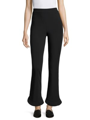 "Image of High-waist pant featuring a ruffled circle leg opening. Elasticized waist. Rise, about 10"".Inseam, about 28"".Leg opening, about 16"".Nylon/cotton/elastane. Dry clean. Imported. Model shown is 5'10"" (177cm) wearing US size 4."