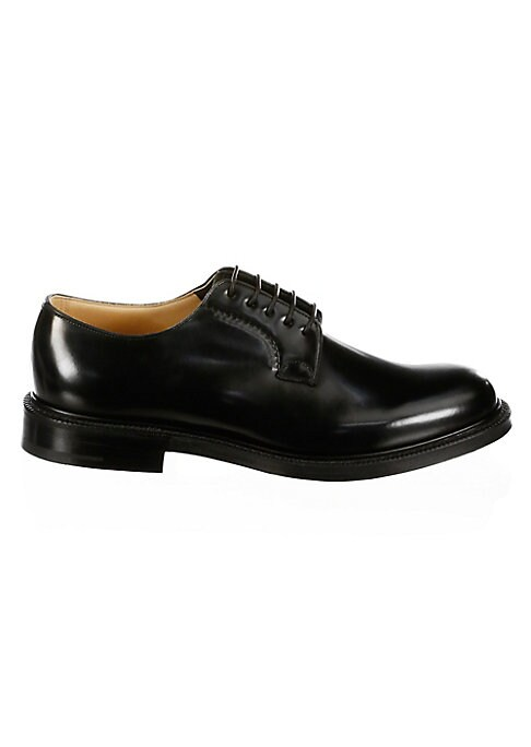 Image of .Leather oxfords with luxurious and timeless appeal. .Leather upper. .Almond toe. .Lace-up vamp. .Leather lining and sole. .Made in UK. .