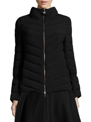 """Image of Quilted jacket with solid design. Stand collar. Long sleeves with adjustable drawstring. Exposed front zip. Side zip pockets. Polyamide/nylon. Dry clean. Imported. Model shown is 5'10"""" (177cm) wearing US size 4."""