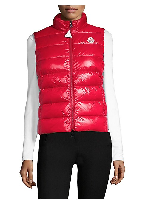 """Image of Puffer vest with chest logo detail. Stand collar. Sleeveless. Side zip pockets. Exposed front zip. Polyamide/nylon. Dry clean. Imported. Model shown is 5'10"""" (177cm) wearing US size 4."""