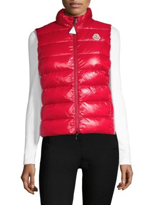 "Image of Puffer vest with chest logo detail. Stand collar. Sleeveless. Side zip pockets. Exposed front zip. Polyamide/nylon. Dry clean. Imported. Model shown is 5'10"" (177cm) wearing US size 4."