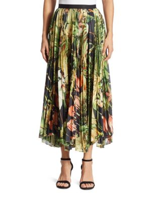 "Image of Ethereal pleated skirt with vibrant tropical motif. Banded waist. Concealed back zip. Handkerchief hem. Partially lined. About 33"" long. Polyester. Dry clean. Made in USA of imported fabric. Model shown is 5'10"" (177cm) wearing US size 4."