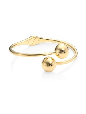"""Image of From the Golden Girl Collection. Sleek bypass bangle capped with gleaming baubles.12K goldplated. Width, about 0.5"""".Hinge closure. Imported."""