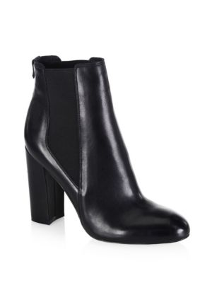 """Image of Durable leather booties render comfort and style. Stacked heel, 4"""" (100mm).Leather upper. Almond toe. Pull-on style. Synthetic lining. Synthetic sole. Imported."""