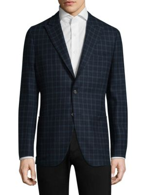 Image of Wool sportcoat in allover check patterned print. Peak lapels with buttonhole. Long sleeves. Split cuffs. Button front. Chest welt pockets. Front patch pockets. Dual back vents. Wool. Dry clean. Made in Italy.