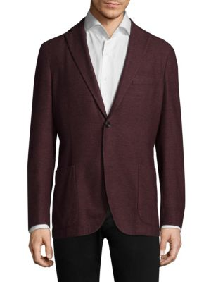 Image of Wool jacket featuring button closure at front. Notch lapels. Long sleeves. Button front. Chest welt pocket. Waist patch pockets. Dual back vents. Wool. Dry clean. Made in Italy.