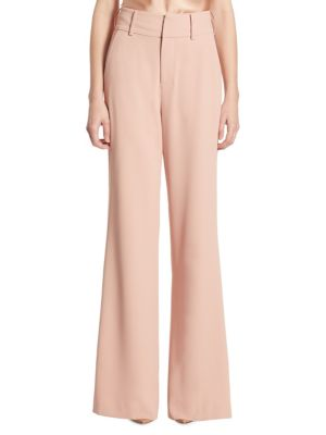 """Image of Elongating high-waist pants in flared silhouette. Belt loops. Zip fly with concealed closure. Side slash pockets. Back welt pockets. Lined. Rise, about 10"""".Inseam, about 32"""".Polyester. Dry clean. Made in USA of imported fabric. Model shown is 5'10"""" (177cm"""