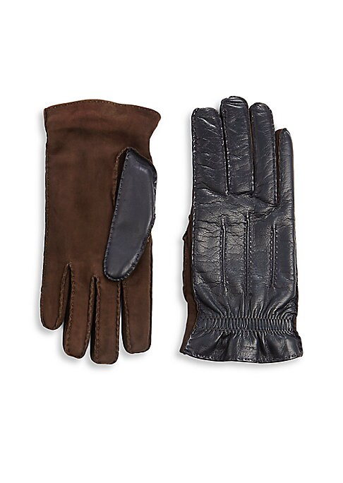Image of Comfortable leather gloves graced with cashmere lining. Cashmere lining. Leather. Dry clean by leather specialist. Made in Italy.